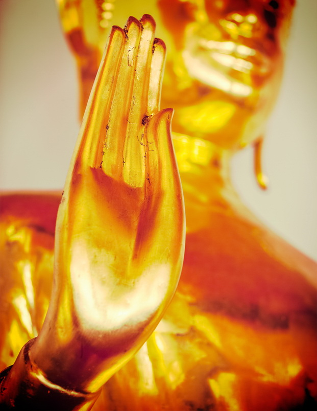 Vintage retro effect filtered hipster style travel image of Buddha golden statue blessing hand, Wat Pho, Bangkok, Thailand. Low point of view